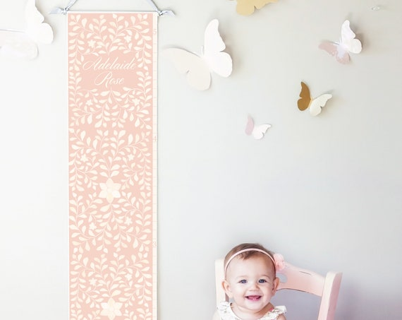 Personalized canvas growth chart with floral bone inlay design in pink