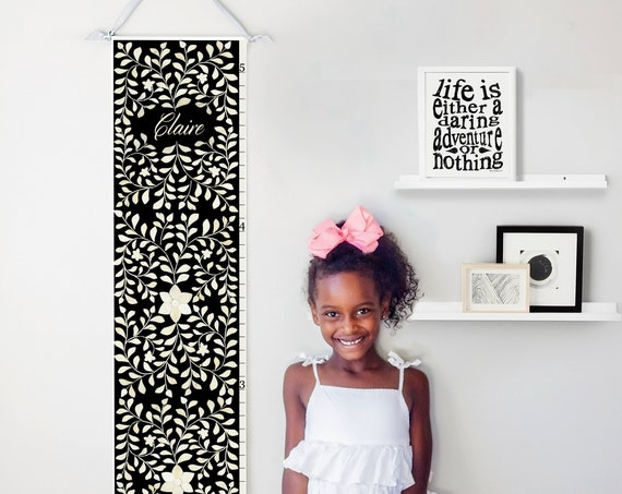 Personalized canvas growth chart with floral bone inlay design in black
