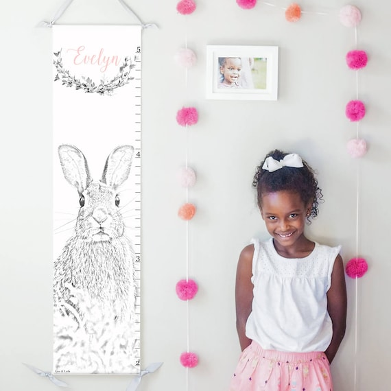 Bunny rabbit canvas growth chart in black, white, and pink