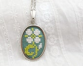 Hand embroidered necklace light flower on green - n050