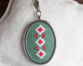 Hand embroidered necklace with ukrainian ornament white and red on green - n002