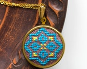 Hand embroidered jewelry with ethnic blue and yellow pattern