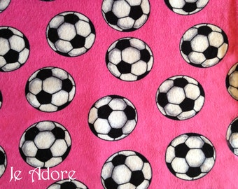 Pink soccer flannel fabric, 100% cotton. Pink with soccer balls. Super cute and delicate. -Sold by the yard-