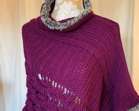 Purple cabled poncho with silver faux fur trim