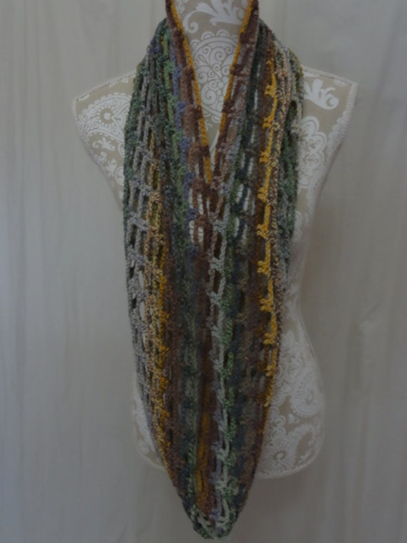 Merino infinity scarf in shades of green, blue, gold, purple and browns