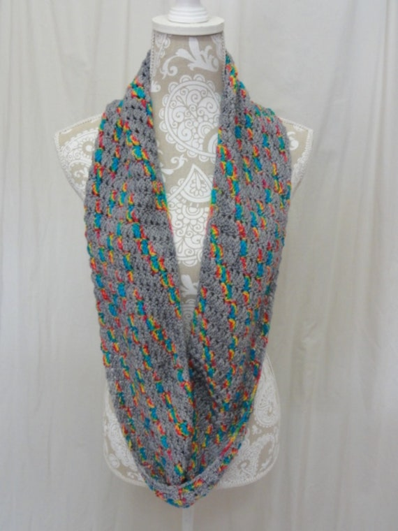Light grey infinity scarf with pops of bright pink, orange, lime green and yellow