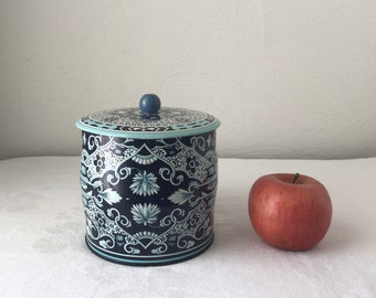Blue and white biscuit tin daher round metal canister made in England