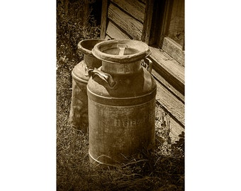 Sepia Photo of a Vintage Creamery Milk Cans by the old Prairie Homestead near the Badlands in South Dakota No.SP7561 A Still Life Photograph