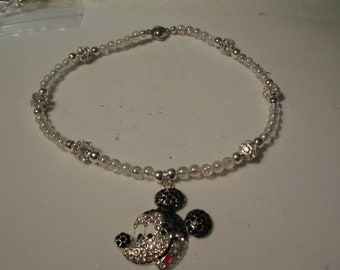Necklace with clear round beads and rhinestone mickey mouse pendant