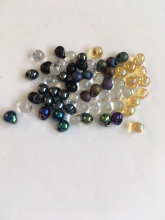 Miyuki 3.4mm Glass Drop Beads available in several colours sold in 9g bottles