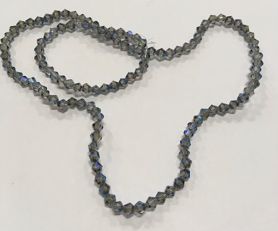 Crystal faceted 4mm bicone glass beads in Light Grey/Blue AB approx 115 beads