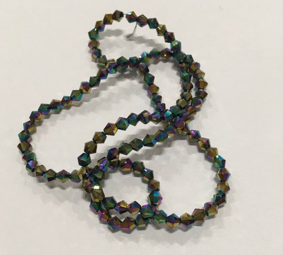 Crystal faceted 4mm bicone glass beads in Multi AB approx 115 beads