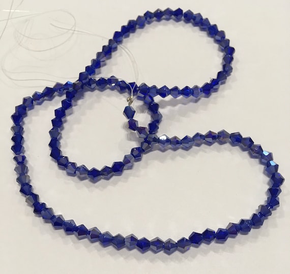 Crystal faceted 4mm bicone glass beads in Cobalt Blue AB approx 115 beads