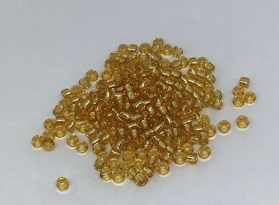 Silverlined Medium Topaz Toho 11/0 Seed Bead in 15g Silverlined gold (TR-11-22B)