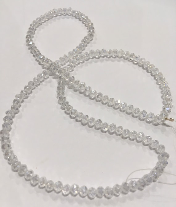 Crystal faceted 4mm donut glass beads in Crystal AB approx 150 beads