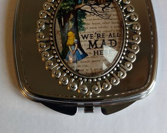 Alice - We're All Mad Here Double sided compact mirror.