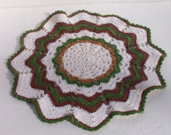 White, green, and tan hand-crocheted doily