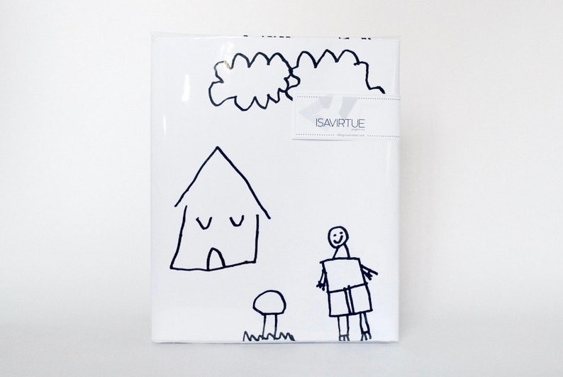 White gift wrap: black and white children drawing houses and image 0