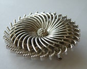 Trifari silver plated pinwheel brooch pin. Layered. Platinum Blondes or Trifari Blondes advertising