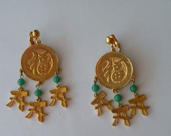 On Sale Asian gold disc with dangles faux jade clip-on earrings.
