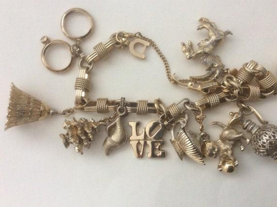 Monet 10 charm  gold tone bracelet. Monet charms.