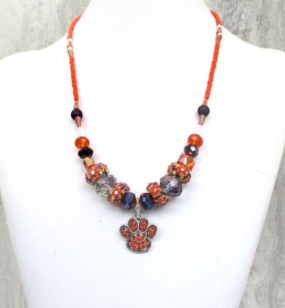 Orange Rhinestone Paw Pendant Necklace with Purple and Orange Glass Beads, Adjustable 18-22in