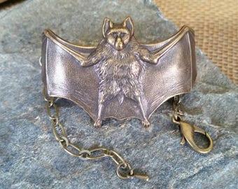 Antiqued Brass Bat Bracelet