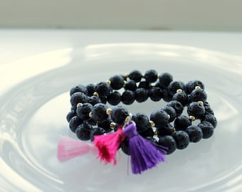 Beaded Stretch Bracelet with Black Lava Stone Beads and Tassel Charm