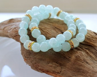 Beaded Stretch Bracelet featuring Aqua Glass and Gold Rhinestone Accents