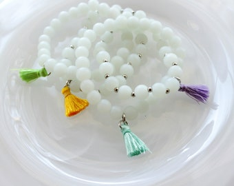 Beaded Stretch Bracelet with White Matte Glass Beads and Tassel Charm