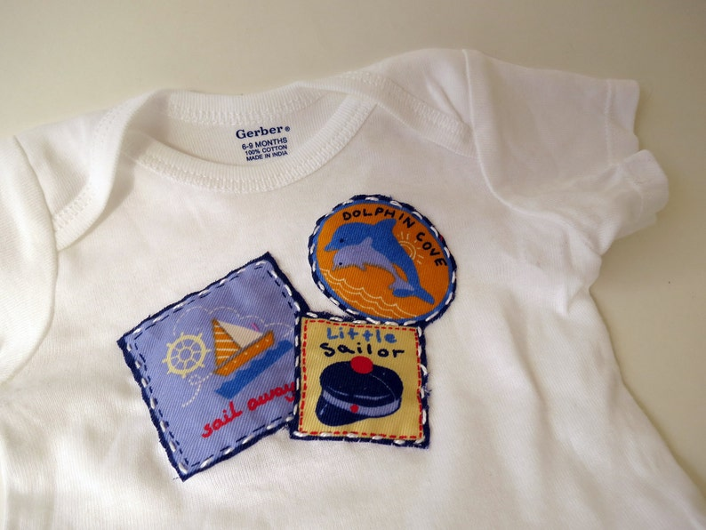 Dolphin Cove Little Sailor baby bodysuit or onesie size 6 to 9 image 0
