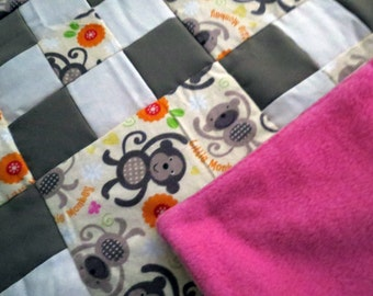 Little Monkey with Flowers baby patchwork quilt in pink, green, orange