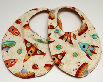 Rockets, Planets, and UFOs baby bib with Burnt Orange