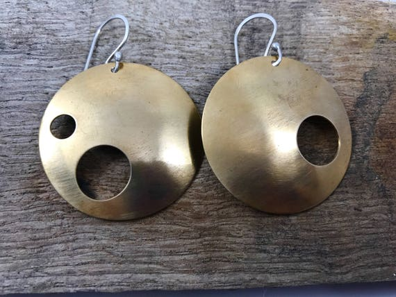 large Domed asymetrical earrings with fun cut outs