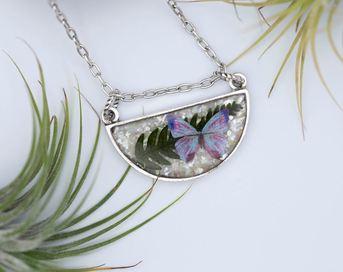 Featured listing image: Blue Butterfly Mother Of Pearl and Fern Leaf Silver Necklace-Morpho Sulkowskyi Butterfly-Crushed Pearl And Real Fern Leaf In Resin