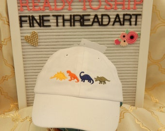 Ready to Ship Infant Baby Baseball Hat Cap White with Dinosaurs Stegosaurus T Rex Brontosaurus Triceratops