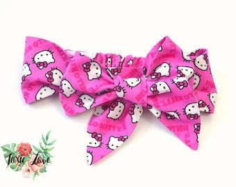Hello Kitty Bow Headband (Sizes Newborn - Adult) Hello Kitty birthday  party 152d10ce2f8