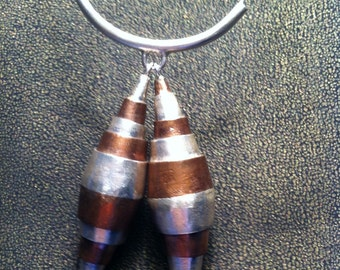 Collapsible Silver and Copper Pendant on Snake Chain.