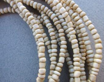 White Goomba Beads -6 Strands