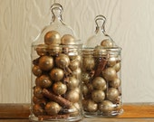 Vintage glass apothecary jars with gold seeds and cinnamon sticks. large set of 2