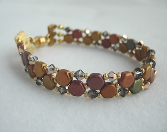 Bracelet with multi colored metallic honey comb beads and crystals, woven look, magnetic clasp, three strands