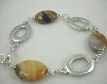 Bracelet with bumblebee jasper and silver links, oval shaped natural stone, muted yellows and black bracelet