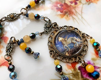 Fairytale necklace with illustration in cabochon.