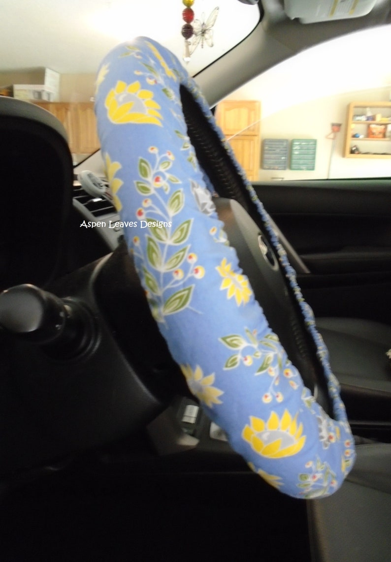 Yellow flowers on blue steering wheel cover. Relaxing blue and image 0