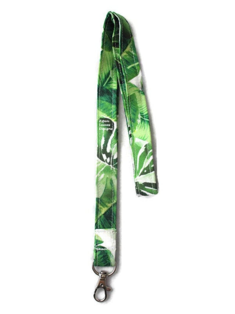 Palm leaves lanyards. Tropical  green leaves on cream fabric. image 0