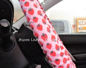 Red strawberry steering wheel cover, Red fruit on pink fabric with dark leaves,