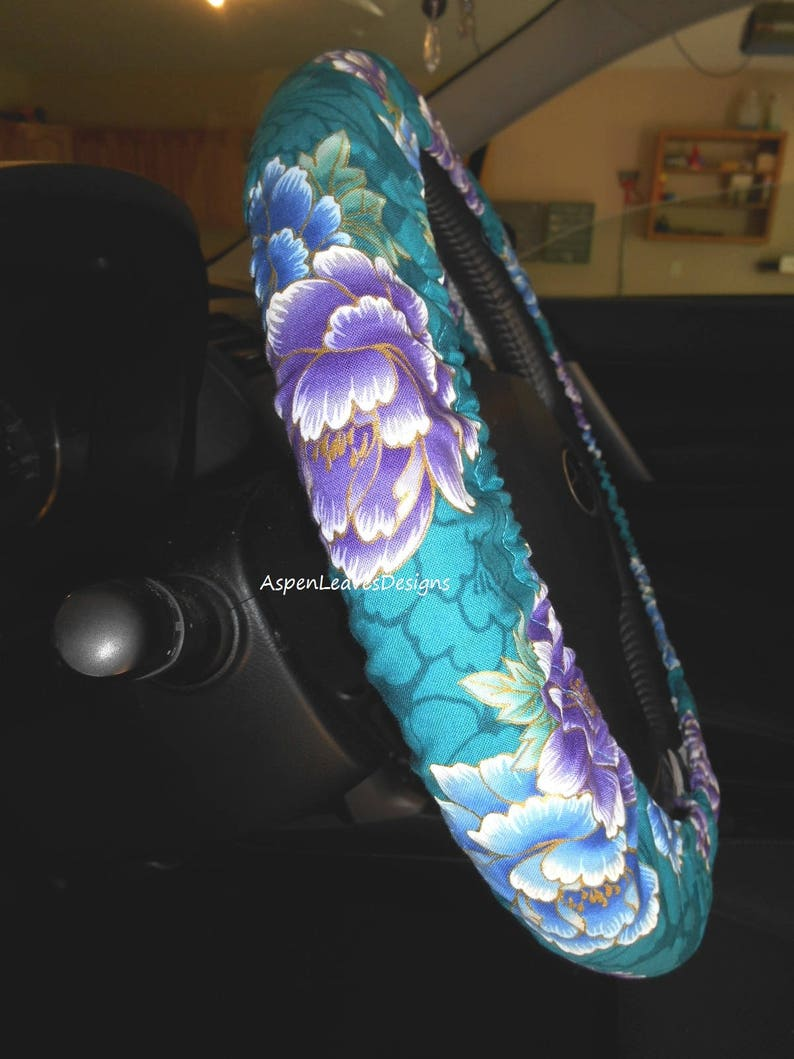 Teal green floral steering wheel cover. Fully lined purple and image 0