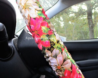 Poinsettia steering wheel cover, Red and white christmas flowers with green leaves on black fabric