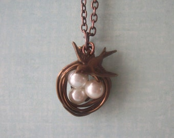 Bird nest pendant with bird charm