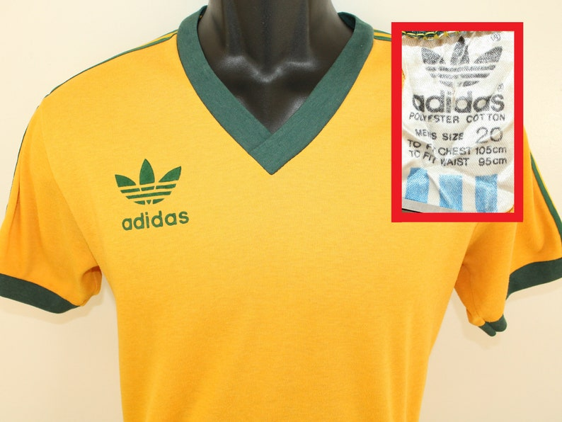 626b69a56b Adidas Australia vintage v-neck t-shirt S/M yellow green 80s cotton poly  trefoil logo graphic country